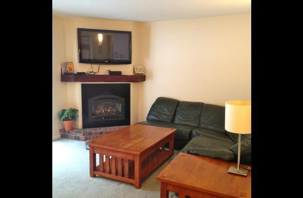 Living room w/ gas fireplace and flat screen tv